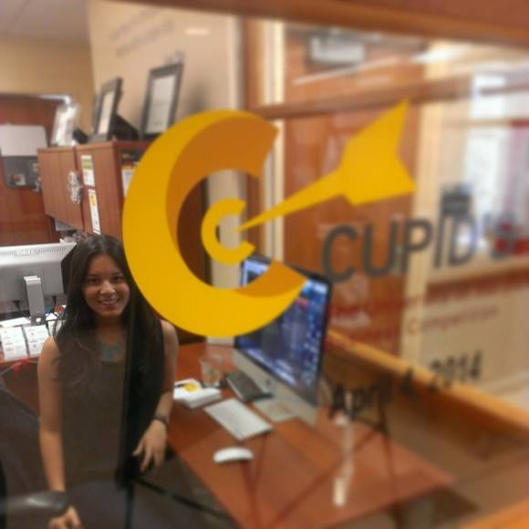 Our Graphic Design Intern, Hannah Shaw, working on the Cupid's Cup brochure.